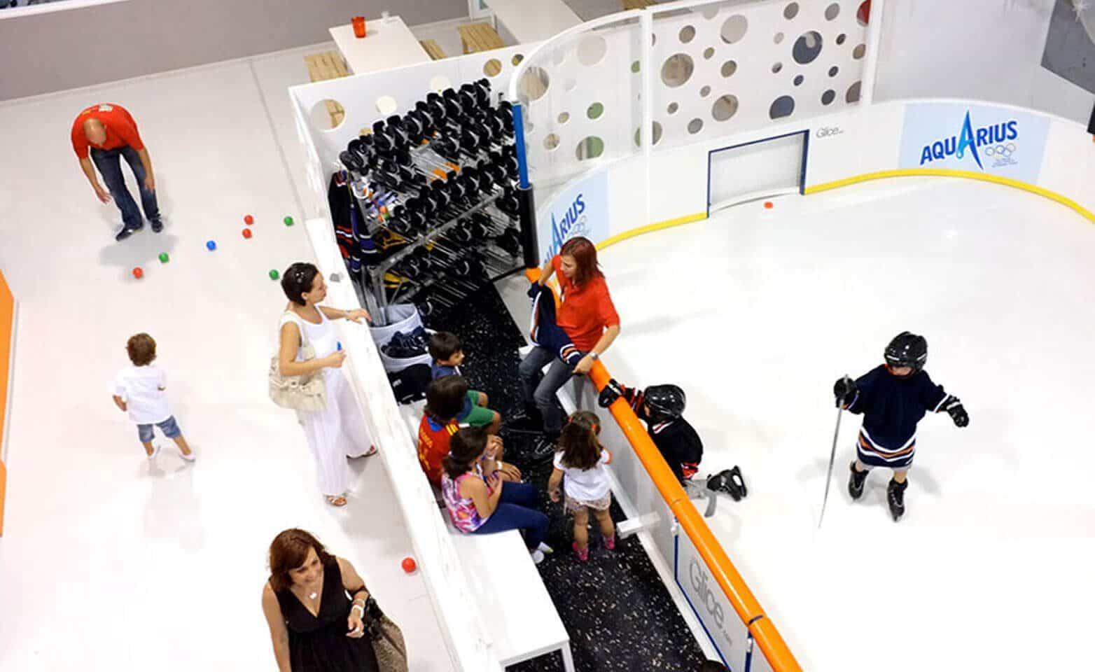 Artificial ice mini arena at entertainment center