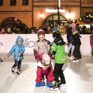 Children enjoying artificial ice rink for Christmas