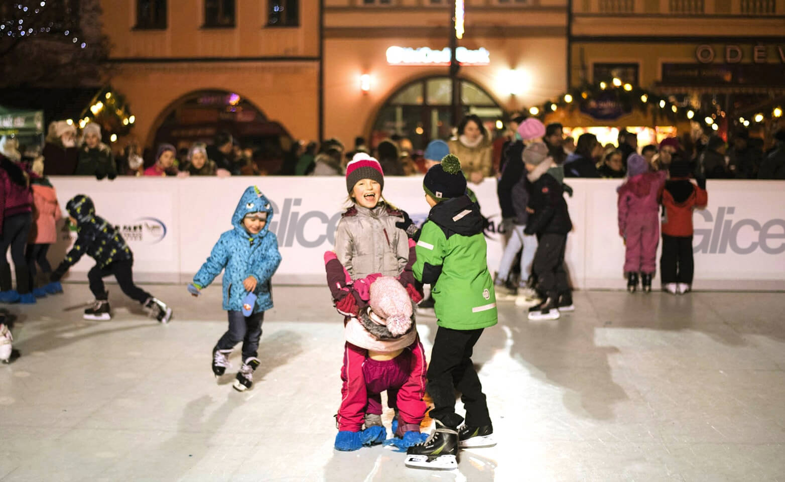 Children enjoying artificial ice rink for Christmas