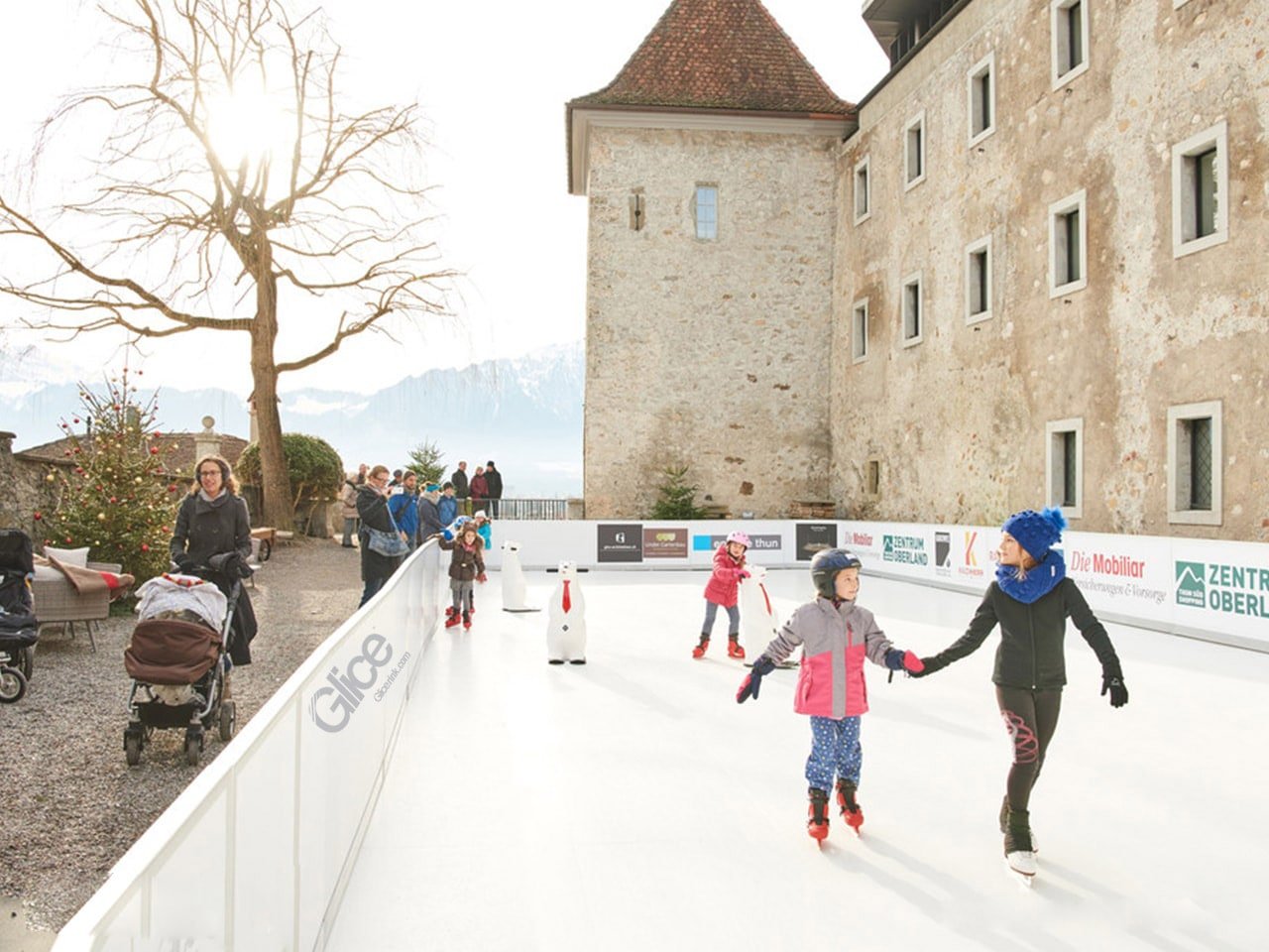Christmas skating on synthetic ice rink in front of castle