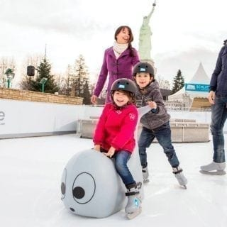 Family skating fun on synthetic ice rink at Austrian amusement park