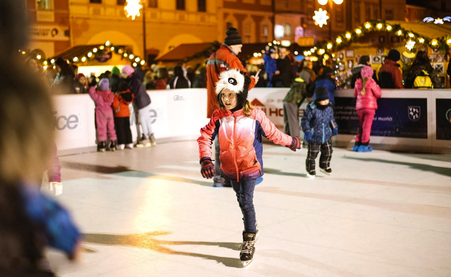 Girl skating on artificial Christmas rink
