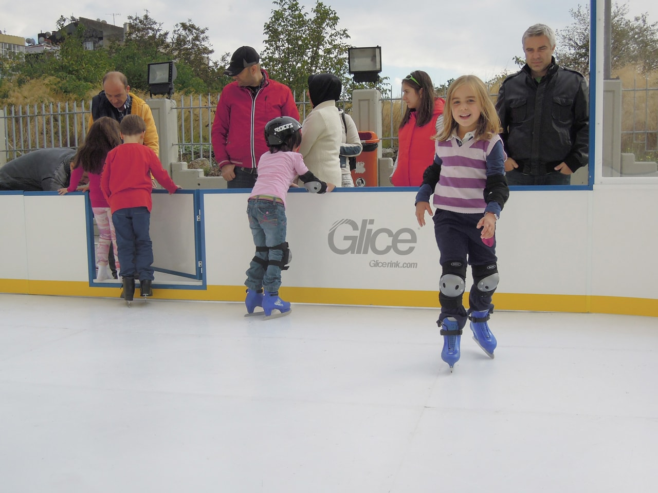 Girl skating synthetic Glice ice