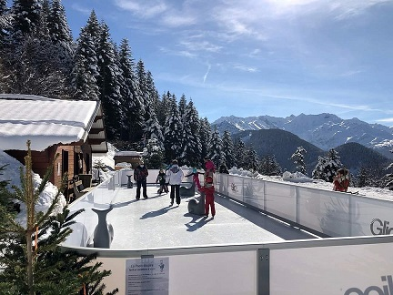 Winter Experience for the Whole Family: Beautiful Glice Synthetic Ice Rink at Ski Resort in the French Alps