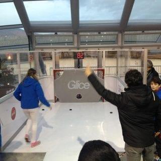 Having fun at plastic ice slapshot station