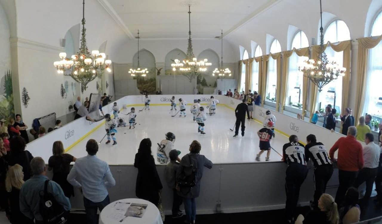 Hockey match on synthetic ice hockey rink in ballroom