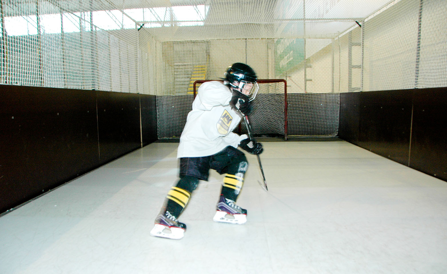 Ice hockey player on artificial ice surface