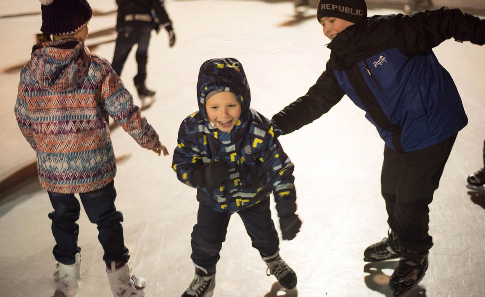 Kids having fun on an artificial Christmas rink
