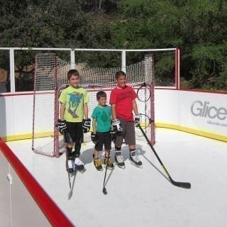 Kids on synthetic ice rink mini arena
