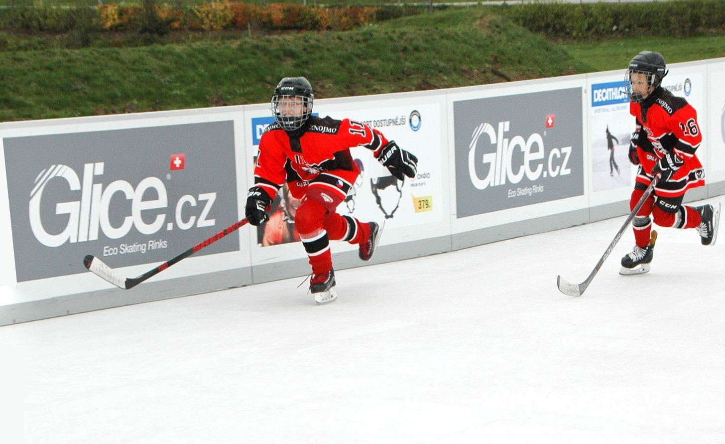 Kids playing hockey on synthetic ice rink surface