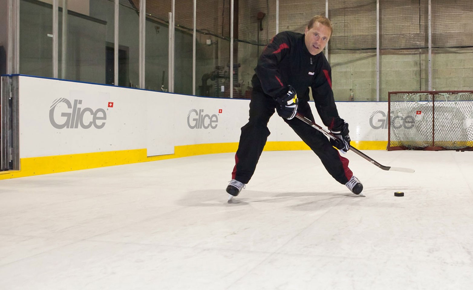 NHL veteran Cliff Ronning practicing on artificial ice rink