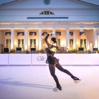Professional figure skater Sarah Meier performing on synthetic ice rink at Grand Hotel Heiligendamm in Germany