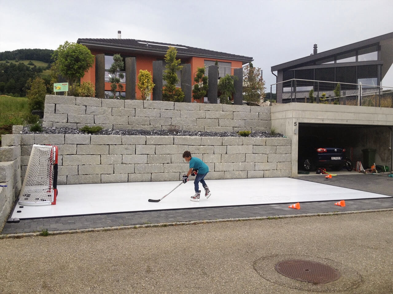 Swiss-kid-practicing-on-artificial-ice-pad