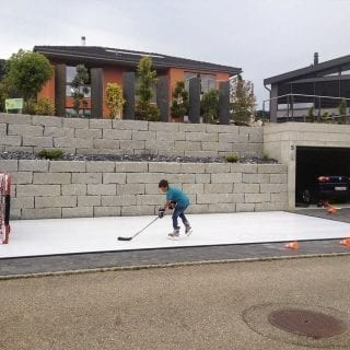 Swiss kid practicing on artificial ice pad
