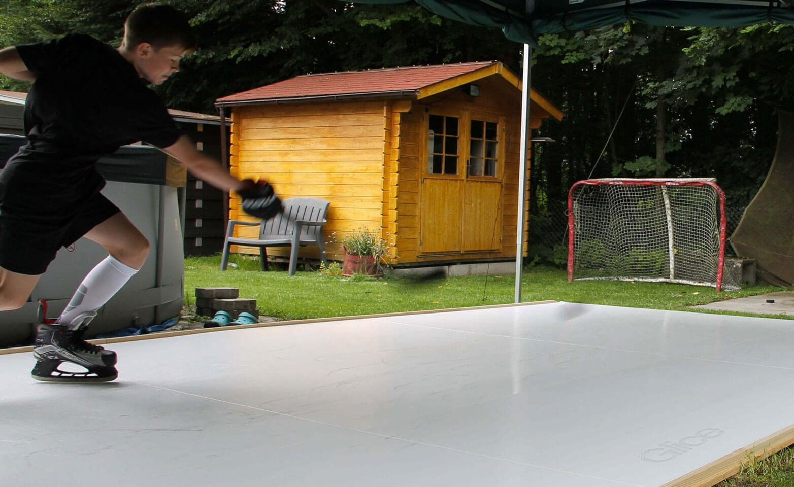 Swiss kid practicing on synthetic ice pad