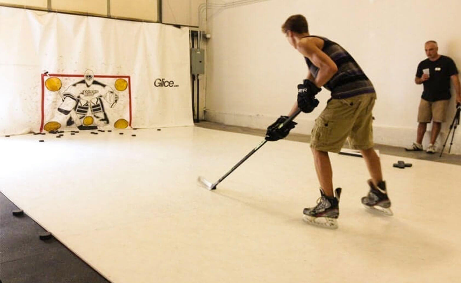 Training hockey on a plastic ice pad at home