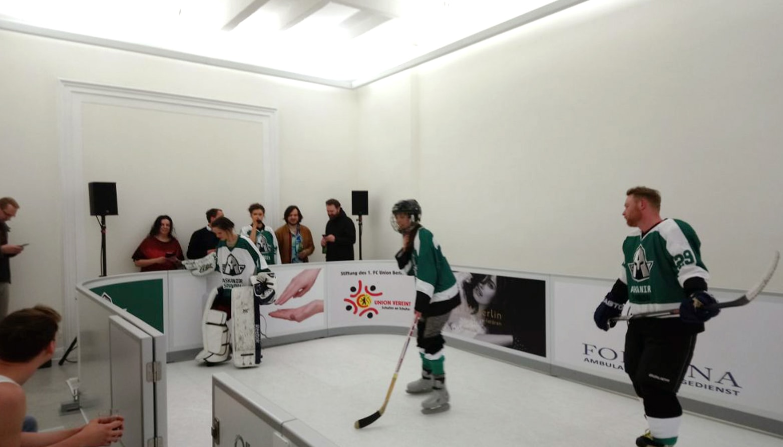 Ice hockey players playing on artificial ice surface