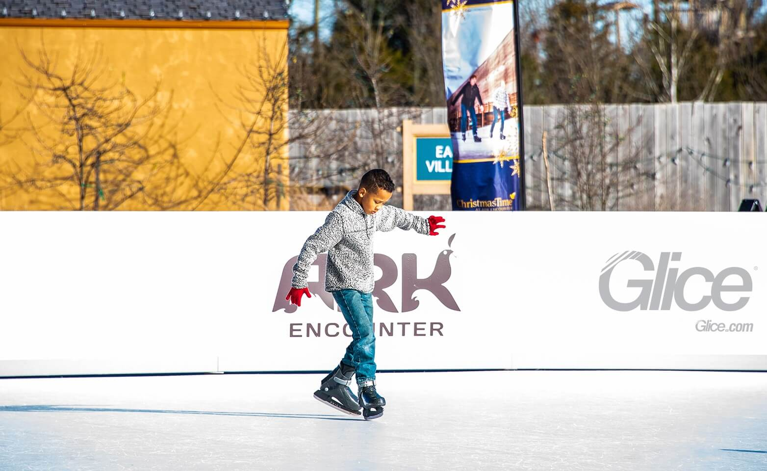 kid on synthetic ice rink at Ark Encounter in the US