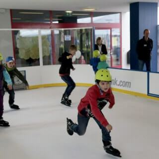 kids skating Glice artificial ice